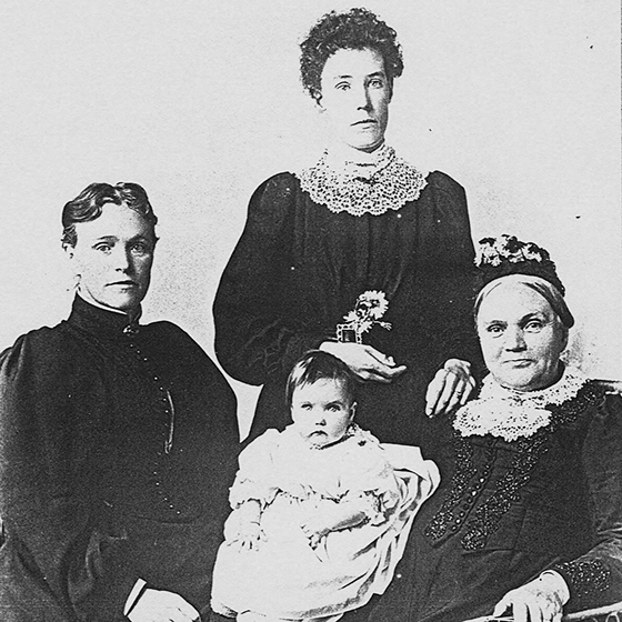 Black and white photo of four generations of women
