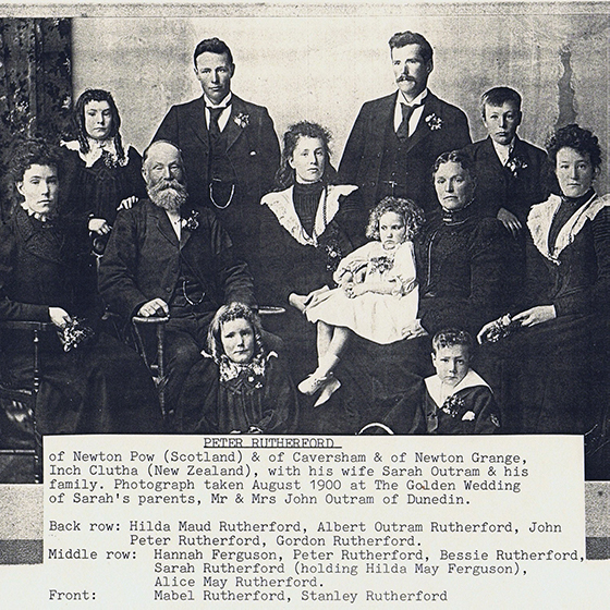 Black & white photo of Peter Rutherford, wife Sarah Outram, and ten children